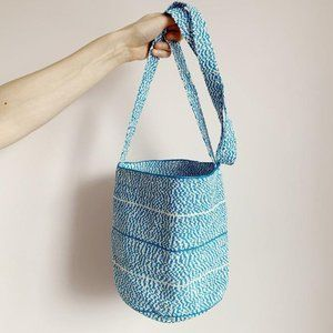 white and blue woven crossbody bucket bag tote